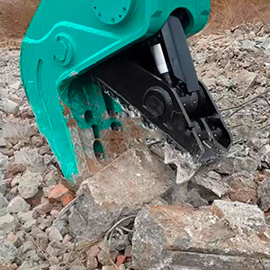 Concrete pulverizer breaking a concrete block